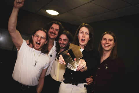 Blossoms pictured with their Official Number 1 Album Award from the Official Charts Company for Foolish Loving Spaces (credit: OfficialCharts.com)