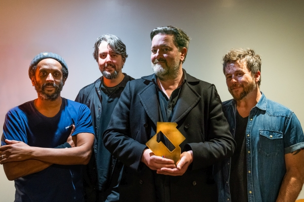 Elbow with their Official Number 1 Album Award from the Official Charts Company for Giants of All Sizes (credit: Peter Neill)