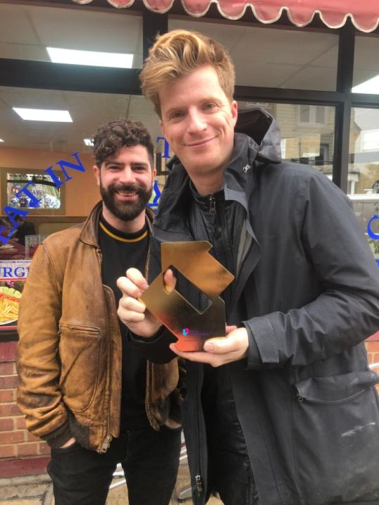 Foals, pictured in Peckham, London, with their Official Number 1 Album Award from the Official Charts Company for Everything Saved Will Not Be Lost – Part 2 [Credit: Phil Christie]