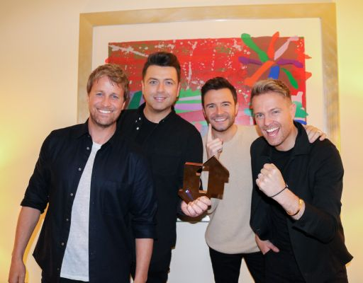 Westlife with their Official Number 1 Album Award for Spectrum (credit: OfficialCharts.com)