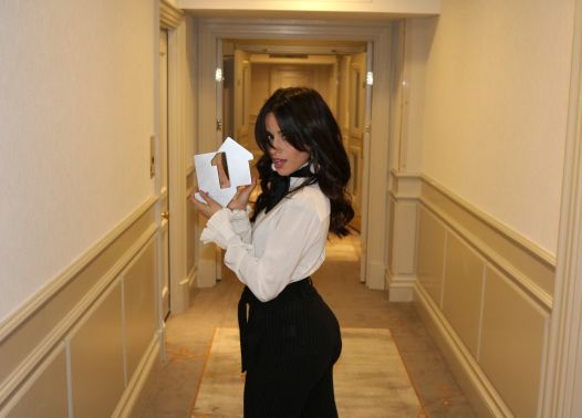 Camila Cabello with her Official Number 1 Single Award from the Official Charts Company for Havana [credit: OfficialCharts.com]