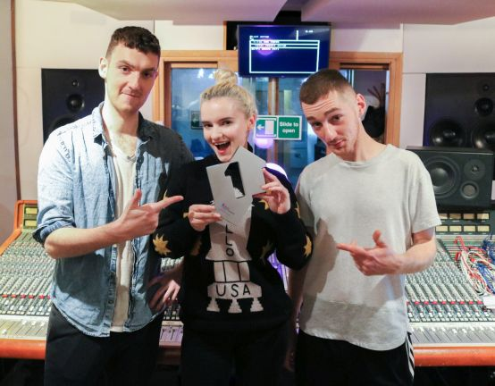 Clean Bandit pictured with their Official Number 1 Award for their single Rockabye [Credit: Official Charts.com]
