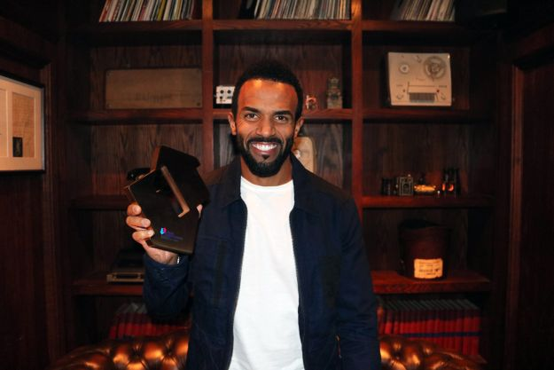 Craig David pictured with his Official Number 1 Award for Following My Intuition, his first Number 1 album in 16 years. [credit OfficialCharts.com]