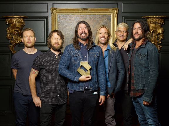 Foo Fighters with their Official Number 1 Album Award from the Official Charts Company for Concrete and Gold [credit: Danny North]