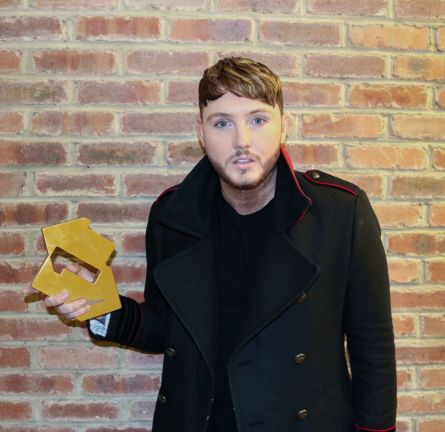 James Arthur pictured with his Official Number 1 Award for his Back From The Edge album [Credit: Official Charts]