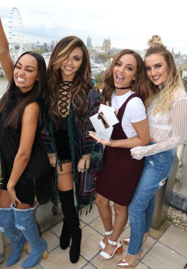 Little Mix pictured with their Official Number 1 Award for their single Shout Out To My Ex. [Credit: OfficialCharts.com]
