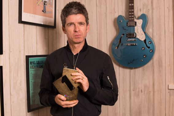 Noel Gallagher with his Official Number 1 Album Award for Who Built The Moon? (Credit: OfficialCharts.com)