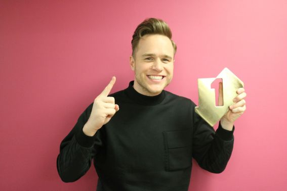 Olly Murs pictured with his Official Number 1 Award for his album 24 HRS [Credit: Official Charts.com]