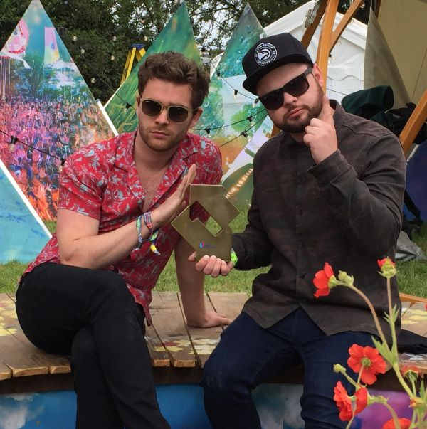 Royal Blood are presented with their Official Number 1 Album Award ahead of their set at Glastonbury Festival. Pic credit: OfficialCharts.com
