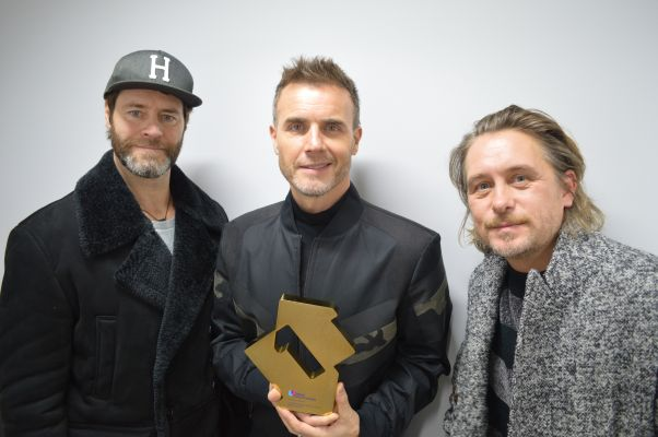 Take That with their Official Number 1 Album Award for Odyssey [Credit officialcharts.com]